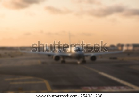 Airplane at Airport. Intentionally Blurred. Background Ready Image.