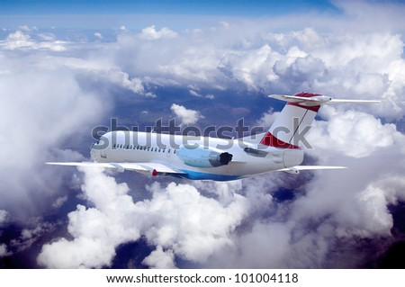 Airplane at fly on the sky with clouds