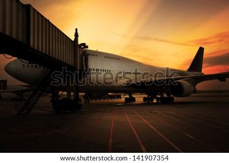 Airplane at sunset - stock photo