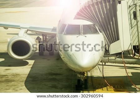 Airplane at sunset, close up - stock photo