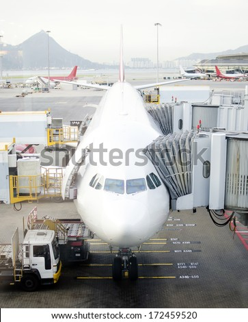 Airplane at the airport parking lot - stock photo