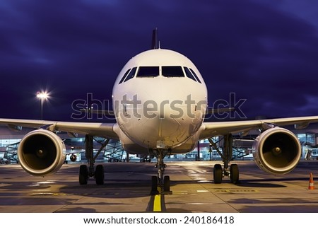 Airplane at the airport - selective focus - stock photo