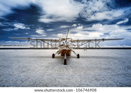 Airplane at the airport. The infrared image. - stock photo