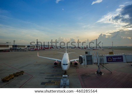Airplane at the terminal gate ready for takeoff - Donmuang international airport during sunrise, Taken in the morning on June 03, 2016.