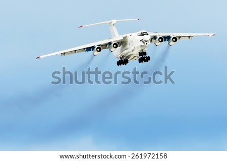 Airplane aviation smoke airport contrail the clouds - stock photo