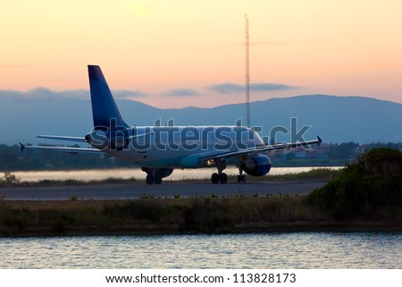Airplane before take-off, evening scene, Corfu
