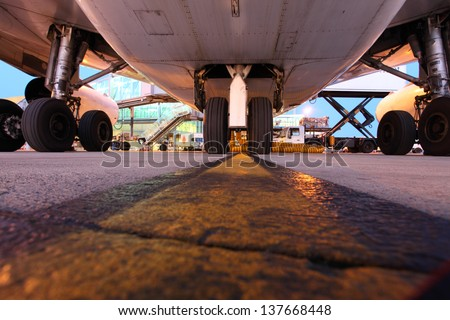 Airplane belly and landing gear - stock photo