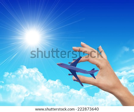 airplane between human hands