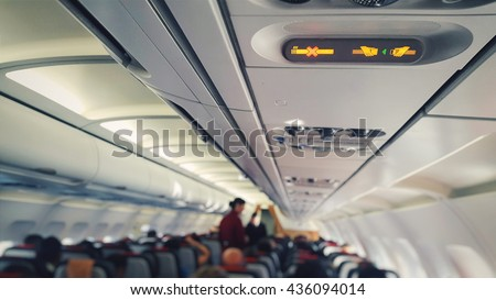 airplane cabin with safety alert icons