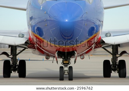 Airplane close up showing landing gear - stock photo