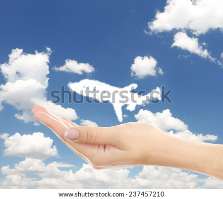 Airplane clouds shape floating on hand