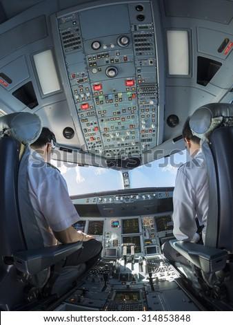 Airplane cockpit fisheye view - stock photo