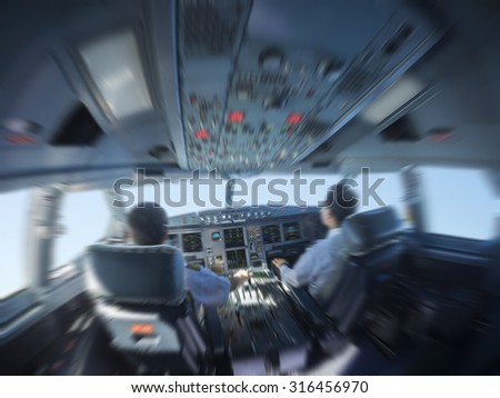 airplane cockpit fisheye view with radial blur effect - stock photo