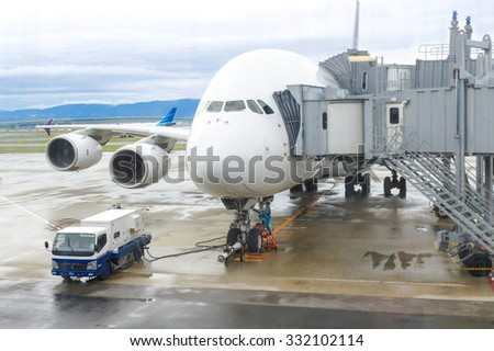 Airplane connected to aero bridge, loading passengers and prepare for take off, travel and business concept - stock photo
