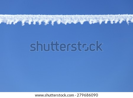 Airplane contrail in the deep blue sky - stock photo