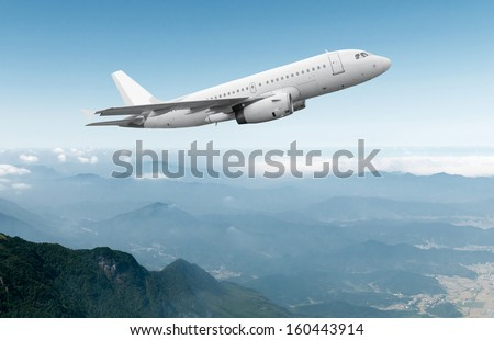 airplane cruising above the clouds - stock photo