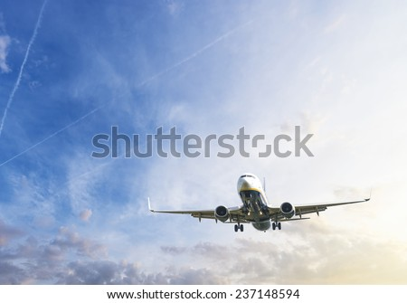 Airplane during landing. - stock photo