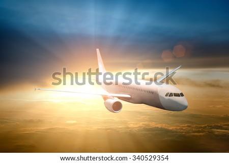 airplane during sunset/sunrise - stock photo