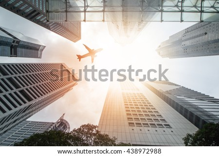 Airplane flight over city building for transportation passengers ,fly travel