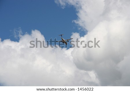 Airplane flight trough the clouds