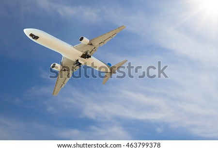 Airplane fly and sunny sky