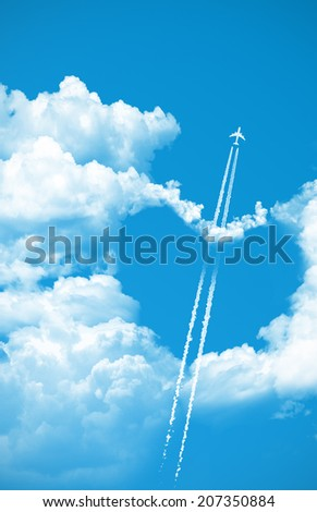 Airplane fly over a heart on the sky - stock photo