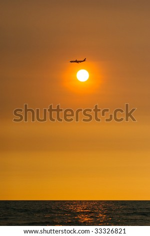 airplane fly over the sun - stock photo