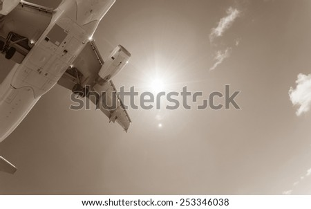 Airplane flying close to ground while landing  - stock photo
