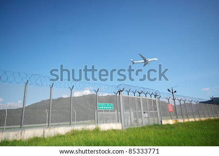 Airplane flying in green airport - stock photo