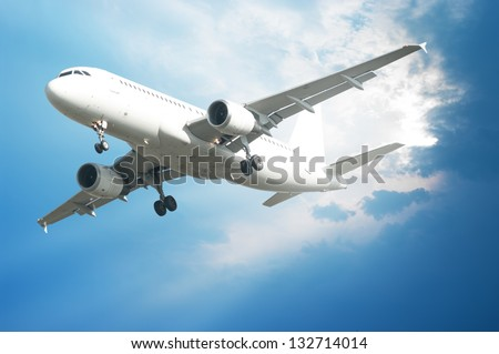 Airplane flying in the air - stock photo