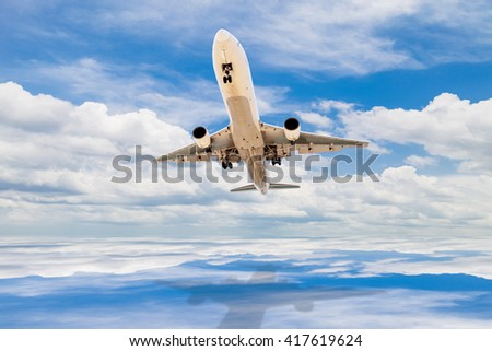Airplane flying in the blue sky and cloud with reflex  - stock photo