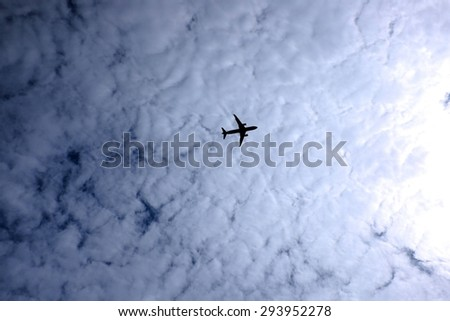 Airplane flying in the sky - stock photo