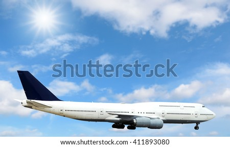 Airplane flying in the sky with beautiful sunlight.