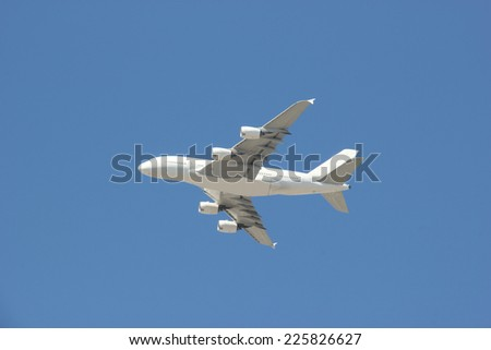 Airplane flying on Bright Blue Sky