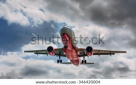 Airplane flying through clouds - stock photo