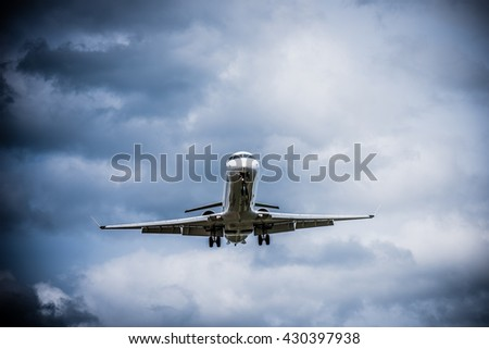 Airplane flying with clouds in background