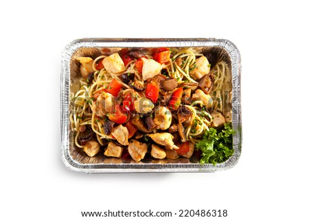 Airplane Food - Noodles with Fried Fillet of Chicken and Vegetables - stock photo