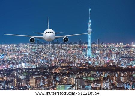 Airplane frying over the Japan cityscape background