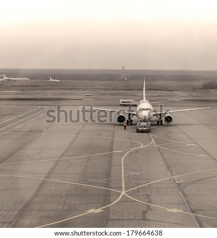Airplane has just arrived and is parked - stock photo