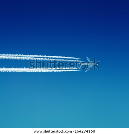 Airplane in blue sky - stock photo