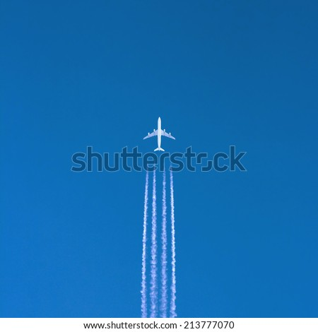 Airplane in clear sky - stock photo