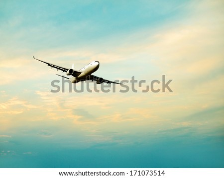 Airplane in clouds background.  - stock photo