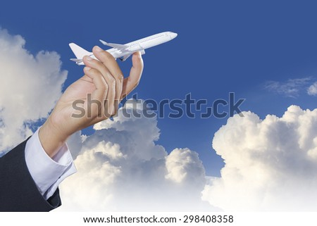 Airplane in hand on blue sky