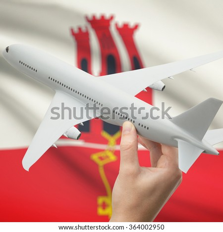 Airplane in hand with national flag on background series - Gibraltar - stock photo