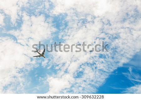 Airplane in sky background. Image with selective focus - stock photo