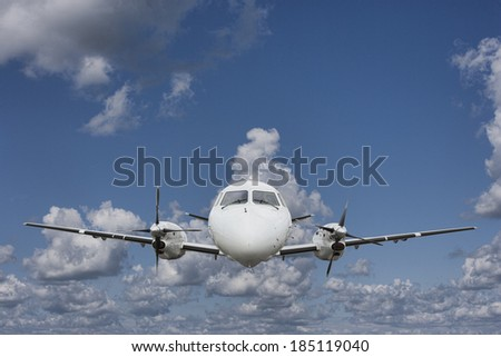Airplane in the air on a sunny day - stock photo