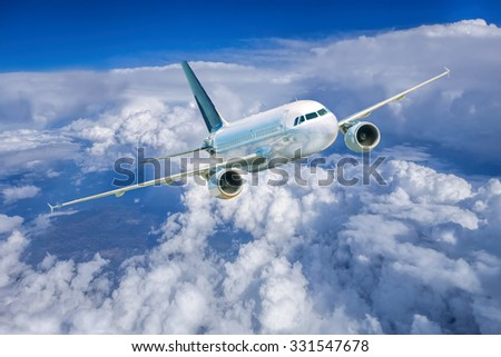 Airplane in the sky against cloudy