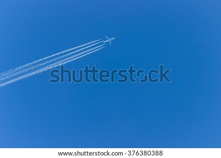 Airplane in the sky. An airplane trail across the sky