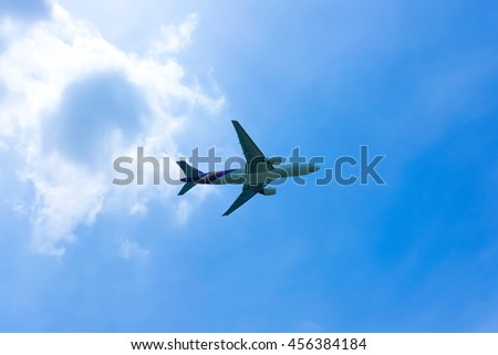 Airplane in the sky and cloud at sunrise,blurred - stock photo