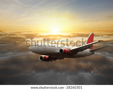 Airplane in the sky at sunset  - Passenger Airliner / aircraft